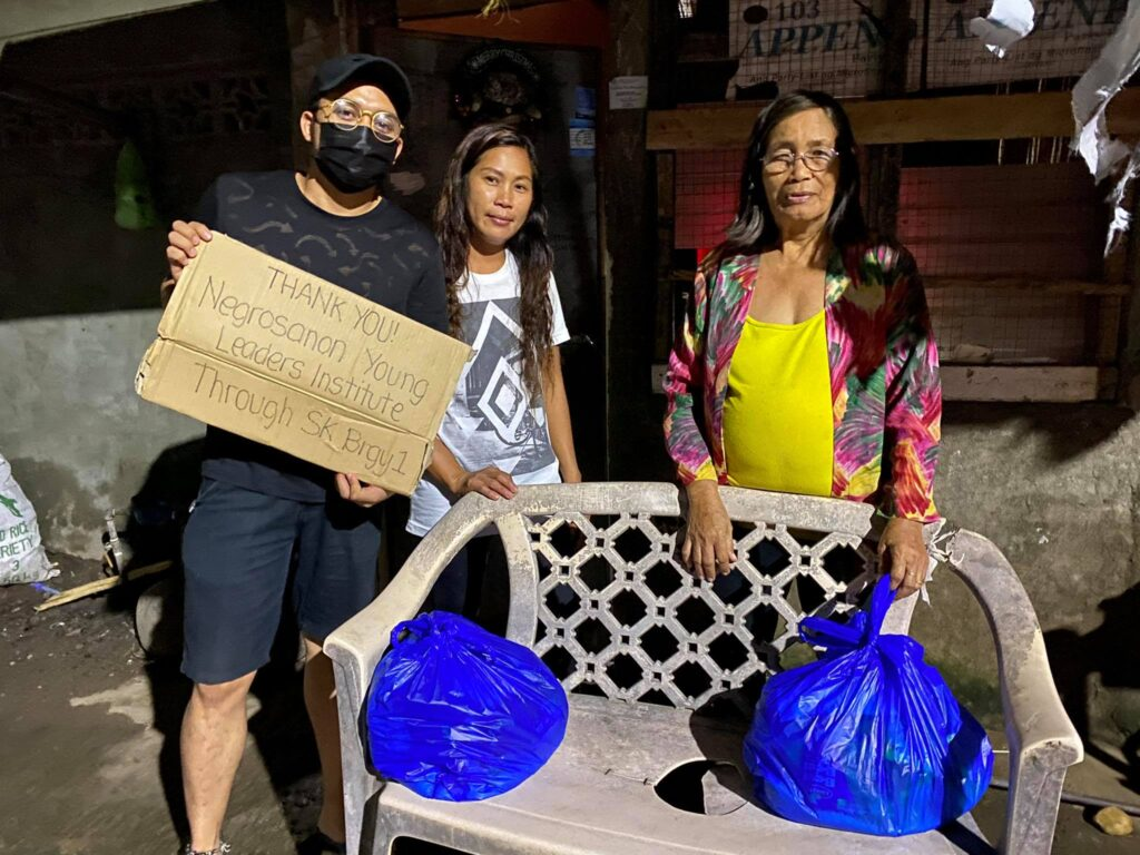 NYLI Inc pool funds to help victims of flooding in Negros 1
